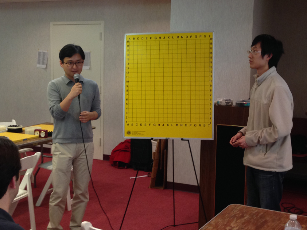 Myung and Andy prepare to review his game.