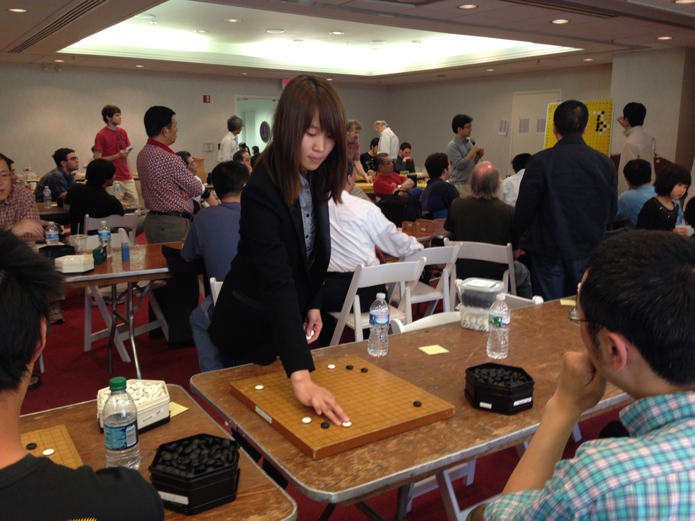 They setup the table to have four boards on each side so she could easily navigate back and forth.