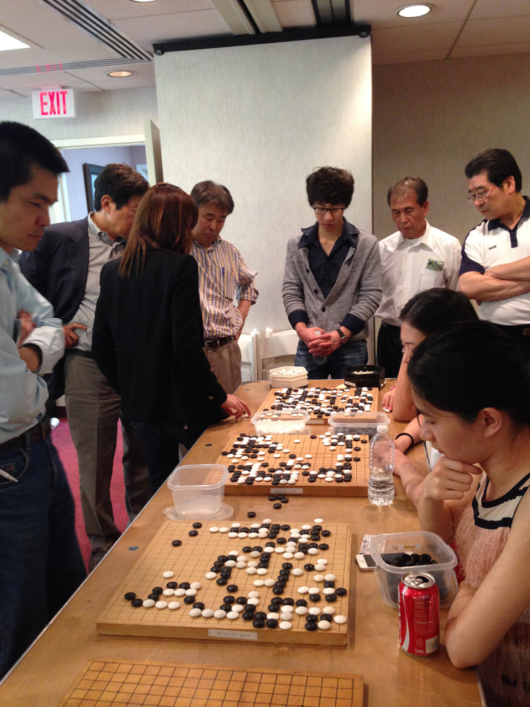 Here you can see a group of Korean players analyzing the board at the far end.